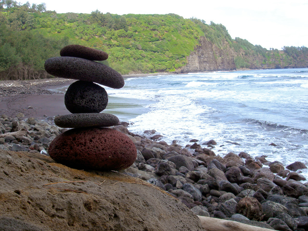 Image of stacked rocks on a beach in color